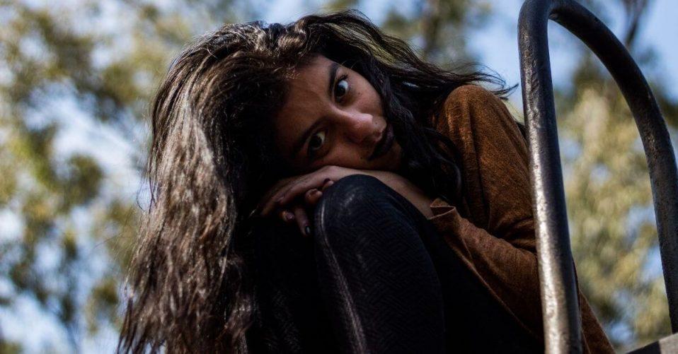sad teen girl looking down