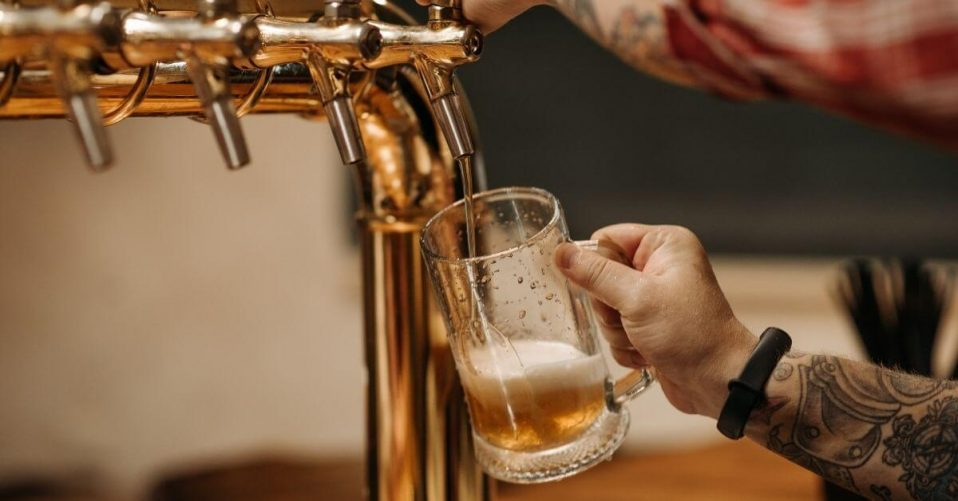 someone serving a pint of beer